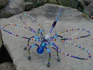 Beaded dragonfly on stone